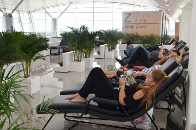 A group of Canadian tourists leaving Vietnam after a one-week visit relax on the lounges. They said theyve been to Tan Son Nhat before, but were forced to sit on the ground while waiting for their flight. Very nice, very clean, very professional, a foreign tourist said, sitting on one of the chairs.