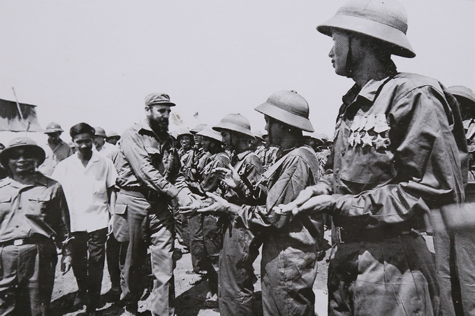 In an olive military uniform, President Fidel Castro shakes hands with every single Quang Tri soldiers before he leaves