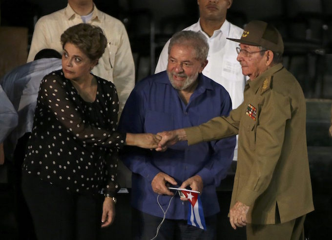 ormer Brazilian Presidents Dilma Rousseff and Luiz Inacio Lula da Silva speak with Cuban President Raul Castro (R) as they attend a tribute to former Cuban leader Fidel Castro in Santiago de Cuba, Cuba, December 3, 2016. Photo by Reuters/Carlos Barria
