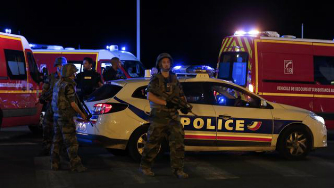 Soldiers and police at the site where at least 30 people were killed in a attack in Nice. Photo by Reuters