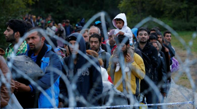 Migrants make their way after crossing the border at Zakany, Hungary October 16, 2015. Photo by Reuters
