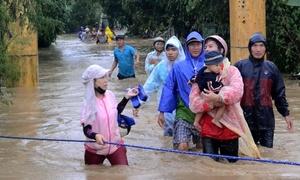Dam discharges flood central Vietnam, again