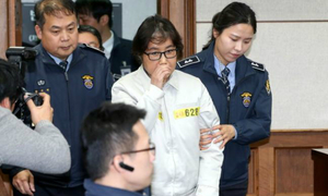 Friend of South Korea's Park denies charges as trial begins