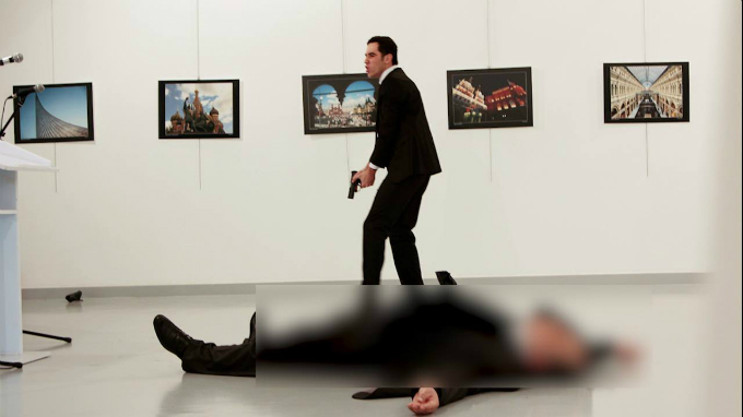 Russian Ambassador to Turkey Andrei Karlov lies on the ground after he was shot by Mevlut Mert Altintas at an art gallery in Ankara, Turkey, December 19, 2016. Hasim Kilic/Hurriyet via Reuters