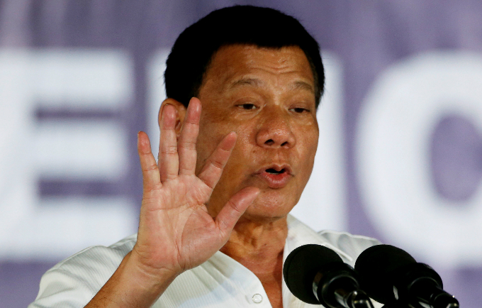 President Rodrigo Duterte speaks in front of housewives and mothers, that participate in the anti-illegal drugs campaign of the provincial government and Dutertes war on drugs at Clark Freeport Zone in Pampanga, Philippines December 22, 2016. REUTERS/Erik De Castro