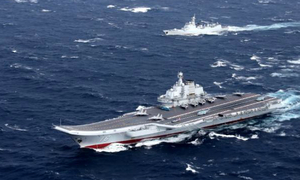 China says aircraft carrier testing weapons in South China Sea drills