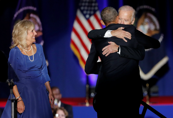 U.S. President Barack Obama hugs Vice-President Joe Biden as Bidens wife Jill looks on after Obama delivered a farewell address at McCormick Place in Chicago, Illinois, U.S. January 10, 2017. REUTERS/John Gress