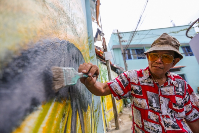 75-year-old-artists-murals-bring-new-life-to-saigon-alleys-1