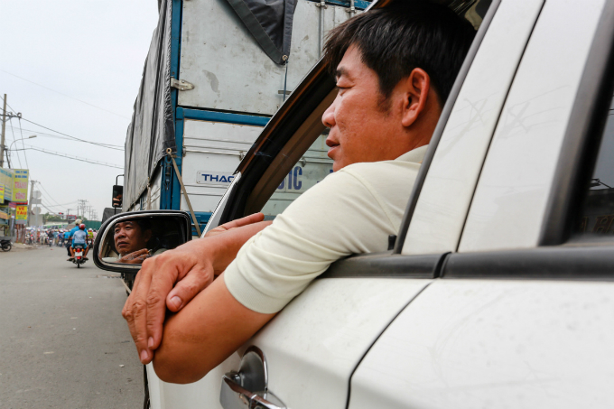 Le Ngoc Thanh, 48, has been stuck in the highway 50 for 3 hours so far