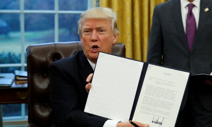 Trump pulls US out of Pacific trade deal, loosening Asia ties