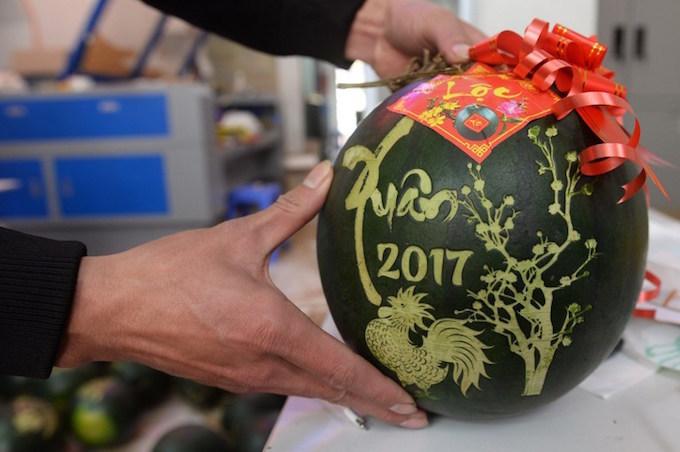 Laser-carved melons lead Vietnam's fancy fruit fetish