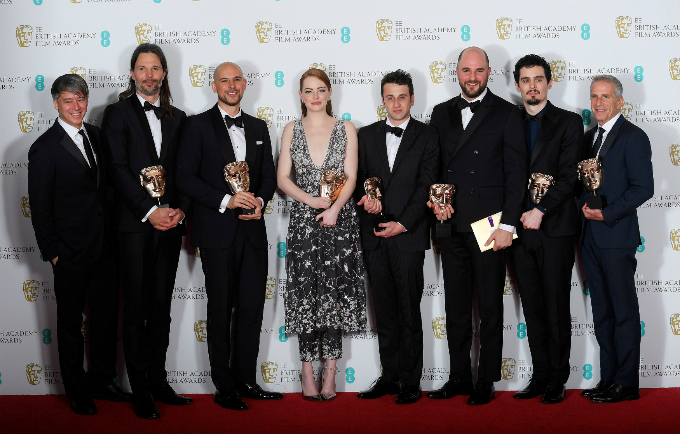 The team behind La La Land hold their awards for Best Film at the British Academy of Film and Television Awards (BAFTA) at the Royal Albert Hall in London, Britain, February 12, 2017. REUTERS/Toby Melville