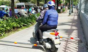 Does Saigon need sidewalk barriers to block dangerous drivers?