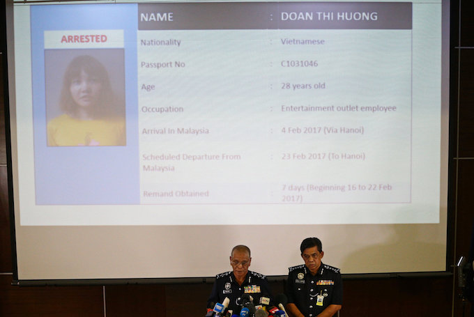 Malaysias National Police Deputy Inspector-General Noor Rashid Ibrahim (front L) speaks in front of a screen showing detained Vietnamese Doan Thi Huong during a news conference regarding the apparent assassination of Kim Jong Nam, the half-brother of the North Korean leader, at the Malaysian police headquarters in Kuala Lumpur, Malaysia, February 19, 2017. Photo by Reuters/Athit Perawongmetha TPX IMAGES OF THE DAY