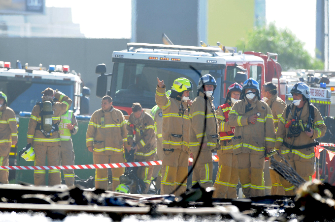 Fire crew at the scene where a light plane crashed into the back of a building at Essendon airport in Melbourne, Australia, February 21, 2017. Photo by AAP/Joe Castro/via Reuters
