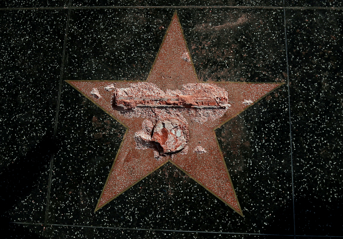 Donald Trumps star on the Hollywood Walk of Fame is seen after it was vandalized in Los Angeles, California U.S., October 26, 2016. REUTERS/Mario Anzuoni/File Photo