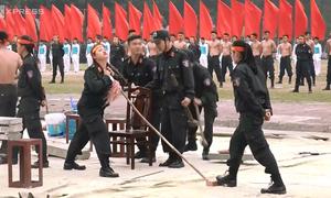 Vietnam's female soldiers smash bricks, bend iron, mean business