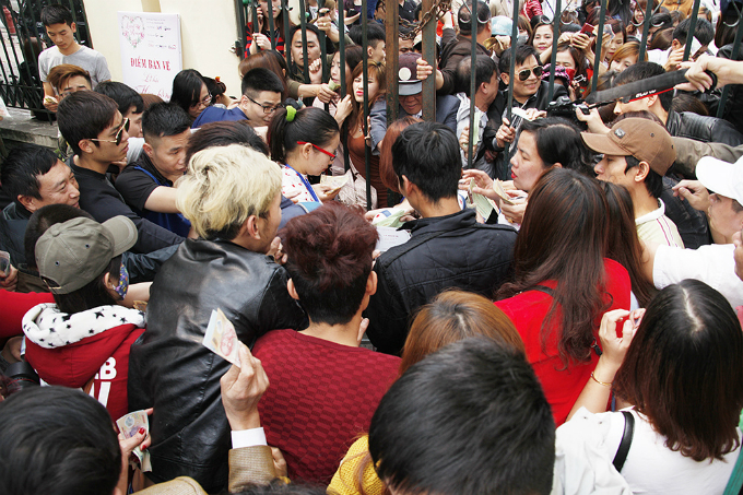 People jostle to buy tickets into the festival on March 3.