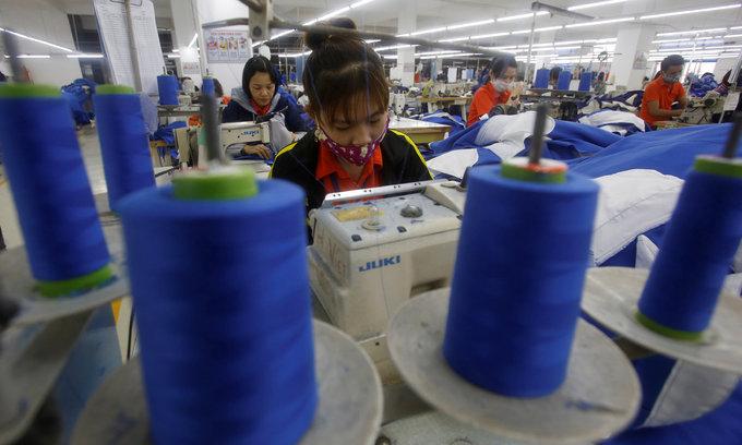 Poor Vietnamese women lining the pockets of world's richest men - Oxfam