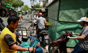 Abandoned security shacks avoid Saigon's sidewalk campaign