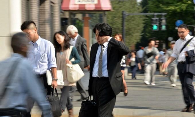 Death by overwork: Japan's 100-hour overtime cap sparks anger