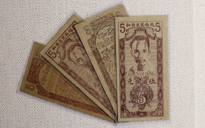 Vietnamese currency during the French domination (1858-1945). Coins with square holes were replaced by those with round holes.