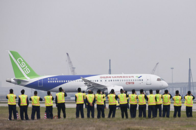 Chinas home-grown C919 passenger jet prepares to take off from Pudong International Airport in Shanghai on May 5, 2017. Photo by AFP/Aly Song