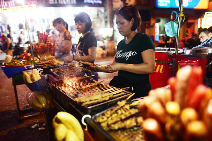 Binh, another vendor,  sells barbecue in the walking street area. On weekdays I sell in the alleyway.