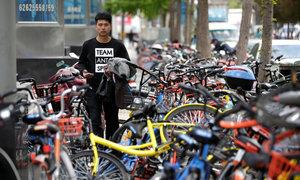 China's bike-share apps flood city sidewalks