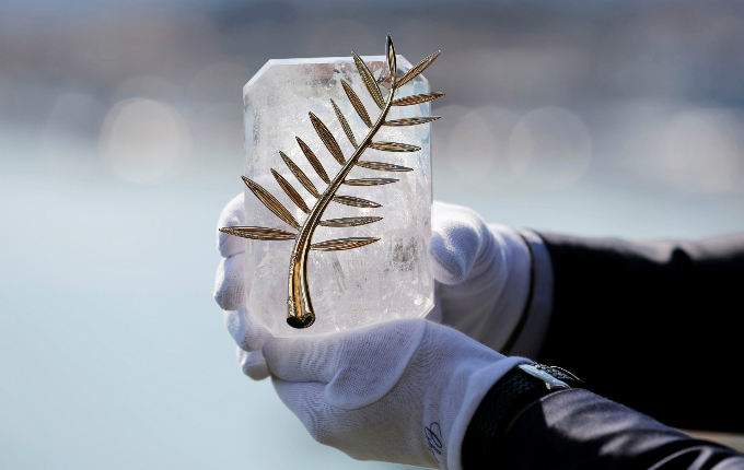 70th Cannes Film Festival - Cannes, France. 16/05/2017 - A Chopard representative displays the Palme dOr, the highest prize awarded to competing films, during an interview before the start. Photo by Reuters/Regis Duvignau