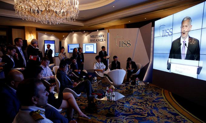 US presses China on South China Sea, calms allies at Shangri-La
