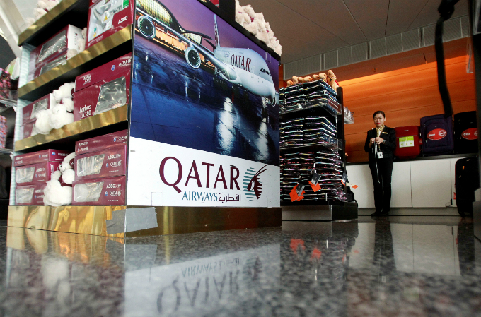 A sign of Qatar Airways is seen at Hamad International Airport in Doha, Qatar, June 7, 2017. Photo by Reuters/Naseem Zeitoon