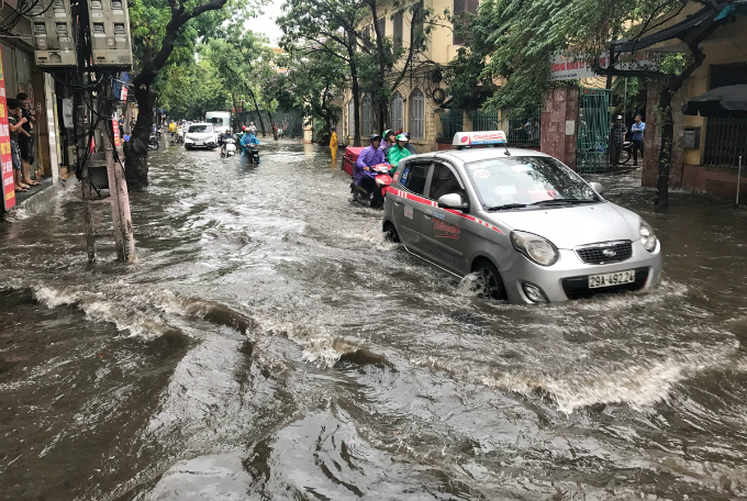 The low-lying Cao Ba Quat Street is often submerged whenever the rain comes.