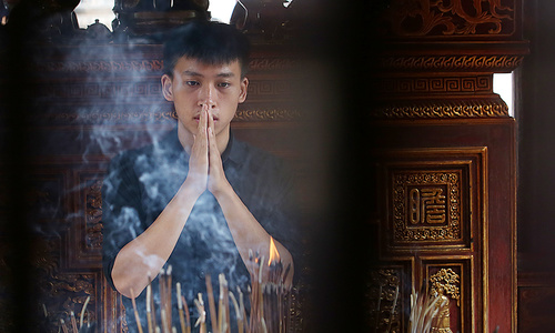 Students pray for luck at Hanoi temple before exam of their lives