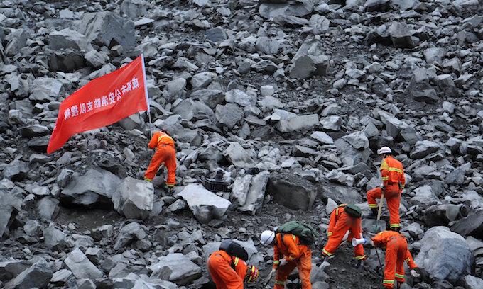 15 dead, over 100 missing in China landslide