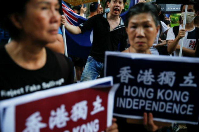 Pro-independence activists take part in a march marking the 20th anniversary of Hong Kongs handover to Chinese sovereignty from British rule, in Hong Kong, China July 1, 2017. Photo by Reuters/Damir Sagolj