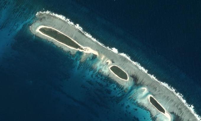 US warship patrols disputed island in South China Sea