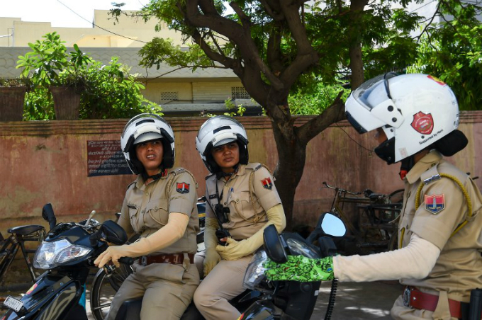 Members of a newly launched female police patrol unit drive through the old city in Jaipur. Photo by AFP/