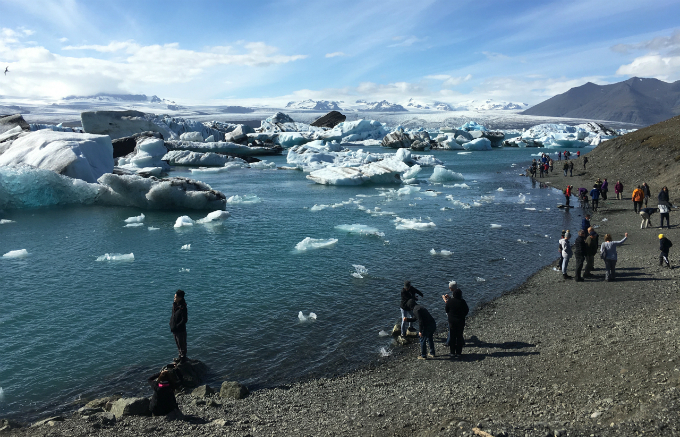 Tourists at the Jokulsarlon, a glacier lagoon in southern Iceland where ice bergs breaking off from the Breidamerkurjokull glacier have formed the countrys deepest lake in the last 80 years, on Jul 4, 2017. Photo by Thomson Reuters Foundation/Thin Lei Win