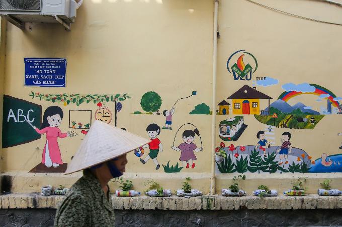 murals-bathe-saigon-alleys-with-a-splash-of-color-6