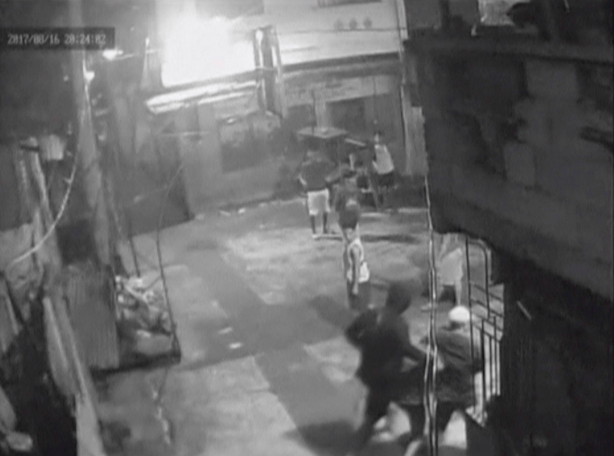 CCTV footage appearing to show Kian Loyd Delos Santos being dragged by plain-clothed police past a basketball court in Caloocan City Barangay, Philippines August 16, 2017 in this still image taken from video. Courtesy of Caloocan City Barangay 160/Handout via Reuters