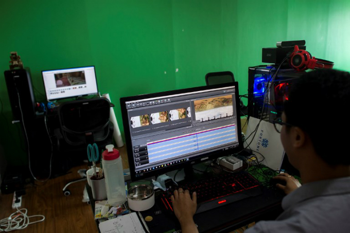 n editor cuts at a studio in Yangon some of the 360˚ 4K video footage that was recorded at the ancient city of Bagan of its crumbling 700-year-old buildings. Photo by AFP