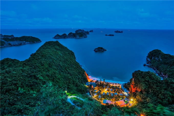 Looking for some fresh air, turquoise sea and interesting caves? Welcome to Cat Ba Island. At night, a resort is the islands single source of light, covered by dark green canopy of a jungle.