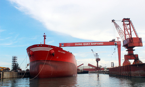 Vietnam energy giant tries to bail from sinking shipyard after years of debts and losses