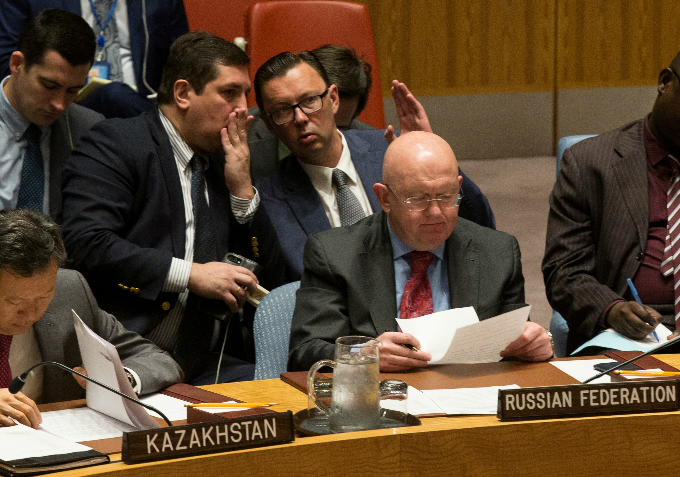 Russian diplomats gesture behind Russian Ambassador to the United Nations Vassily Nebenzia during a Security Council meeting on North Korea at the U.N. headquarters in New York City, U.S., September 4, 2017. Photo by Reuters/Joe Penney