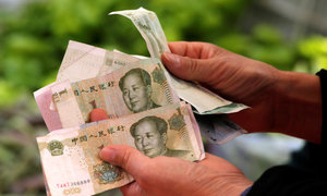 China raises yuan rate to 16-month high as dollar sags