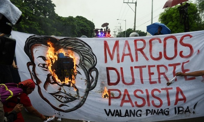 Late Philippines strongman Marcos' 100th birthday draws praise, protests