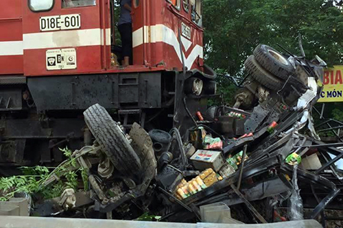 Driver survives after train plows through truck in Hanoi