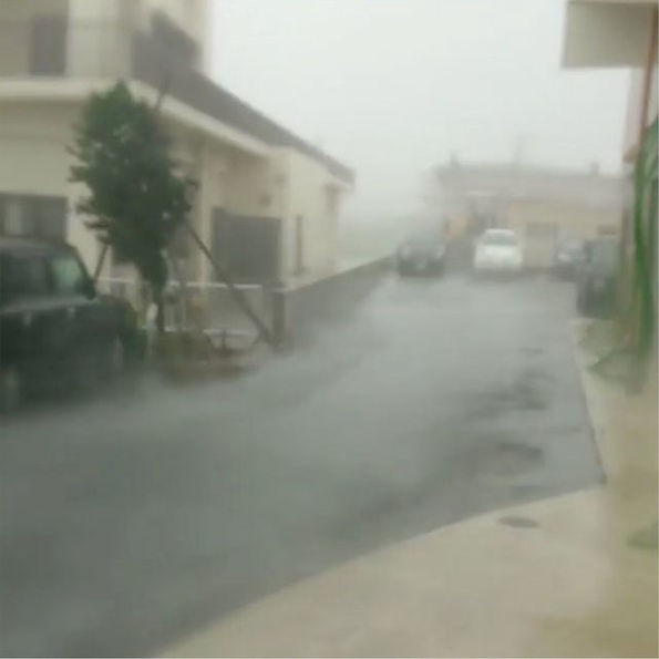 Strong wind and rain are brought by Typhoon Talim in Miyakojima, Japan September 13, 2017 in this still grab taken from a social media video footage from outside Hotel Rising Sun. Photo courtesy of Yasumi Yamamoto/ via Reuters