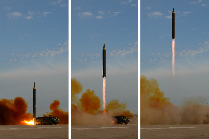 North Korean leader Kim Jong Un (not pictured) guides the launch of a Hwasong-12 missile in this undated combination photo released by North Koreas Korean Central News Agency (KCNA) on September 16, 2017. Photo by KCNA via Reuters